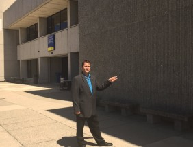 Library Director Brian Beecher points to the temporary LLC entrance.