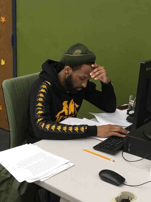 Student finishes an assignment while working at a computer station