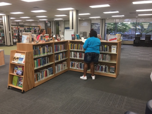 Students perusing New Books titles