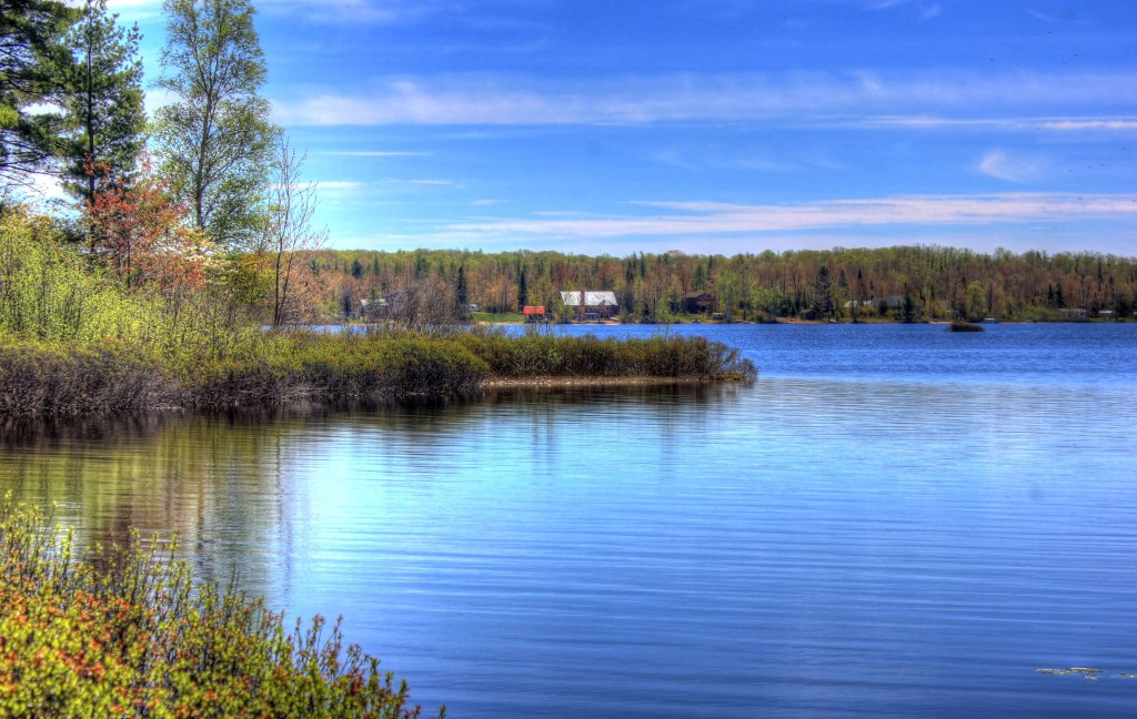 Twin Lakes State Park is a small 175 Acre Park in the Upper Peninsula of Michigan located along MI-26. It features hiking, boat launch, camp grounds, playground The scenic shoreline, the lake, and the sky at Twin Lakes State Park, Michigan